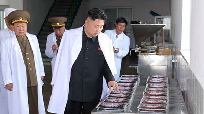 Kim Jong-Un visiting the Korean People's Army-run factory producing varieties of foodstuff at undisclosed place in North Korea (Getty).