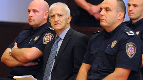 Dragan Vasiljkovic, center, a former Serb paramilitary commander, has been sentenced to 15 years in prison for war crimes in the 1990s (AP Photo, FILE).