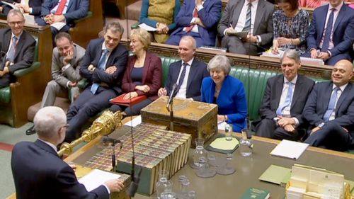 UK Labour leader Jeremy Corbyn and UK Prime Minister Theresa May debate in the House of Commons.