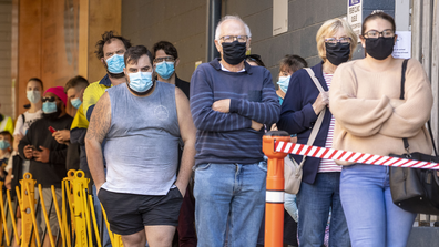 People are seen lining up to be tested for COVID-19 at a testing clinic at Ipswich Hospital on August 24, 2020 in Brisbane, Australia.