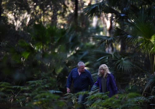 Mark and Faye Leveson, the parents of Matthew Leveson, return to bushland in the Royal National Park along with NSW Police south of Sydney, in 2017. (AAP)