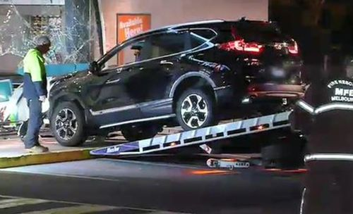The man allegedly rammed his car into the servo after a woman, with facial injuries, ran inside for refuge.