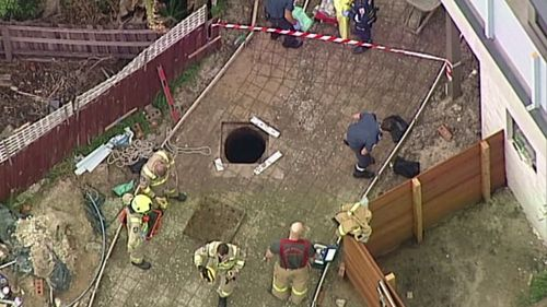 Firefighters have rescued a teenager who was trapped for more than an hour.