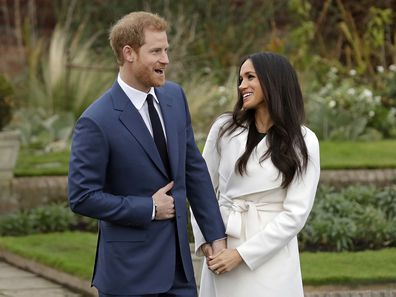 Prince Harry and fiancee Meghan Markle pose for photographers during a photocall announcing their engagement.