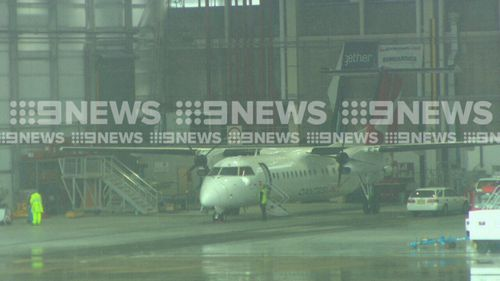 The damaged plane returned to Gate T3 and was towed to an engineering hanger to be inspected. Picture: 9NEWS
