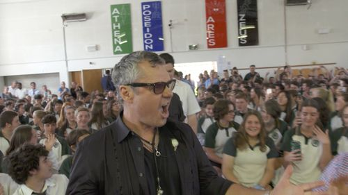 Members of INXS have returned to the schools where it all started. (60 Minutes)