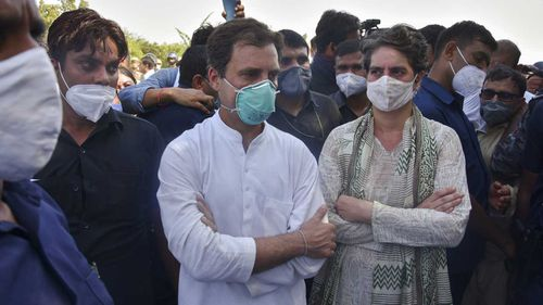 India's opposition Congress party leaders, Rahul Gandhi, center and his sister Priyanka Gandhi stand after they are stopped by police on a highway in Gautam Buddha Nagar, Uttar Pradesh.