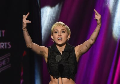 Miley Cyrus sat the the 30th Annual Rock And Roll Hall Of Fame Induction Ceremony in April 2015 in Ohio