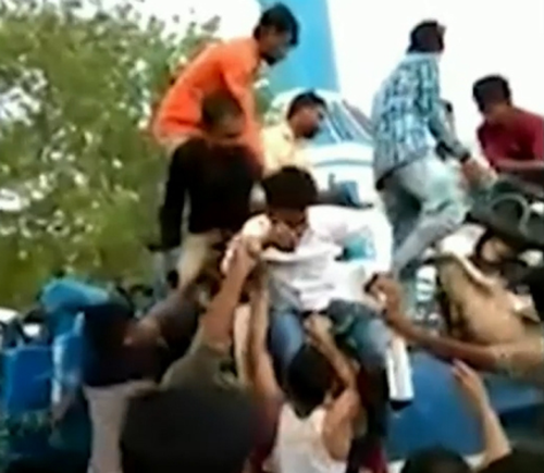 People rush to help those stuck on the ride.