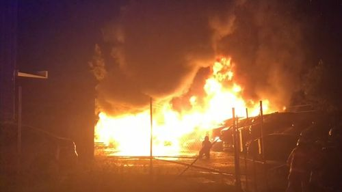 Huge flames broke out in the wrecking yard, but no neighbouring businesses were damaged.