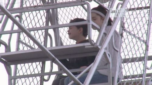 Amber Arndell and her brother, Jessie, trapped on the ferris wheel.