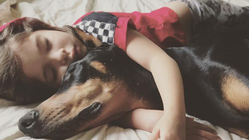 The best friends play, eat, sleep and read together because Buddah will not leave Siena's side. (Facebook)
