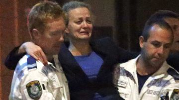 Police Rescue officers carry Marcia Mikhael from the scene. (AAP)