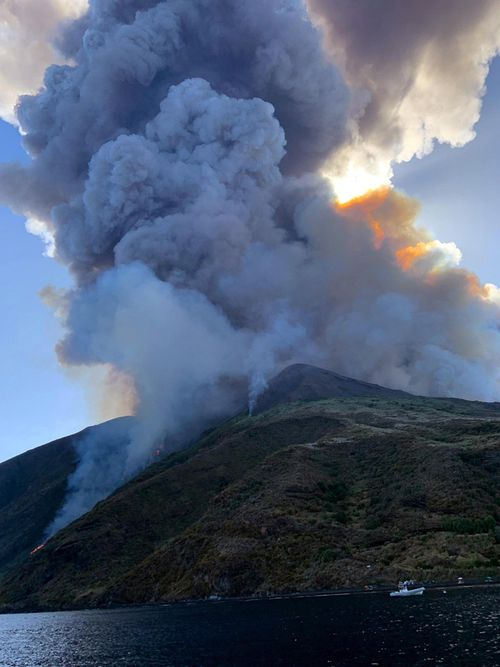 The island of Stromboli was hit by a set of violent volcanic eruptions spurring beach tourists to take into the sea. Two new lava spouts are creeping down the volcano.