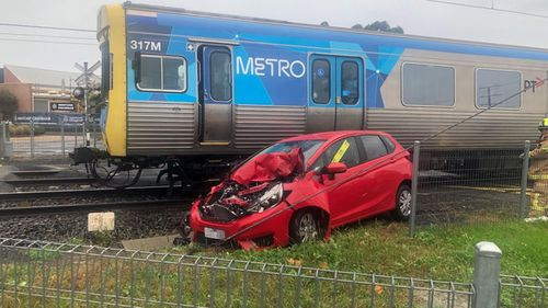The car was struck at the Warrigal Road level crossing in Mentone.