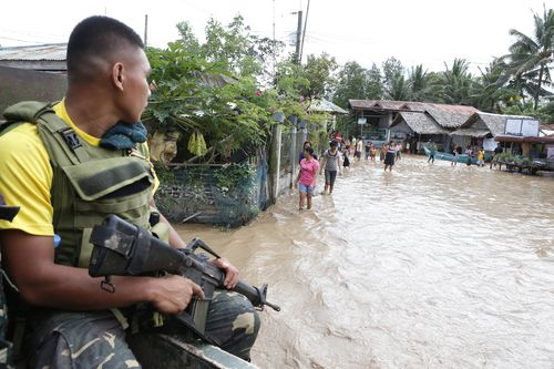The floods were caused by a tropical storm in the southern part of the country. (AAP)