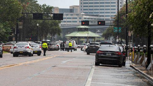 Police have barricaded a street near Jacksonville Landing.