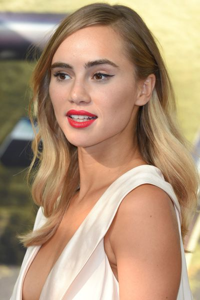 Change up your part. Don't underestimate the power sweeping your hair to one side. If your wet hair dries into a natural wave, give Suki Waterhouse's look a go. If not, part to the side and secure in a low bun at the back of the head.
