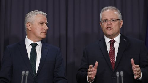 Prime Minister Scott Morrison and Deputy Prime Minister Michael McCormack speak to the media about a ministerial reshuffle at Parliament House in Canberra.
