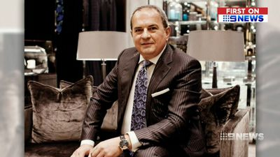 Luxury store owner John Poulakis denies smothering mother with pillow
