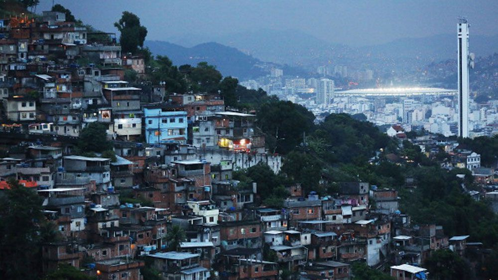 A Rio favela with the Olympic Stadium in the background. (Getty)