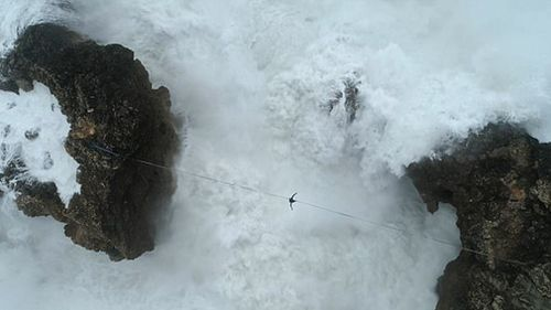Brazilian Emerson Machado has been filmed attempting to walk on a slackline between rock faces in Portugal (Supplied).