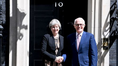 UK Prime Minister Theresa May greets Malcolm Turnbull outside 10 Downing Street. (AAP)