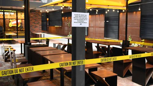 Tables are blocked off at a Melbourne restaurant.