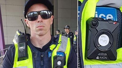 Sticker covers cop's bodycam at climate rally