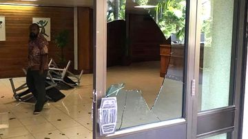 Broken windows, smashed furniture, pictures torn from walls and plants tipped over in PNG pay dispute.