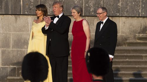 US President Donald Trump and his wife Melania stand with Prime Minister Theresa May and her husband Philip May at Blenheim Palace, Oxfordshire. Picture: PA