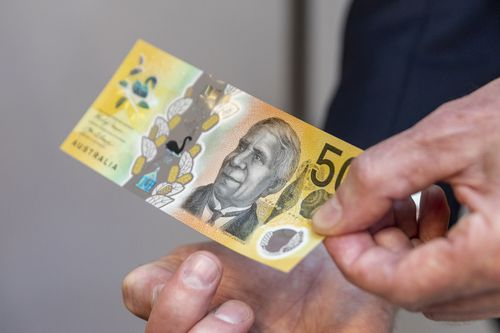 The new note features four raised dots, designed to assist people who are blind or vision impaired.
