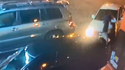 Video showed a man forcing a woman into a white car in Miami.