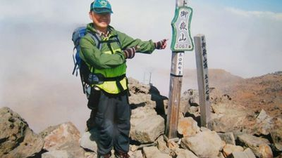 Noguchi, 59, poses on the summit shortly before the eruption.