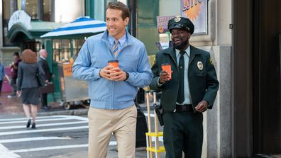 Ryan Reynolds as Guy and Lil Rel Howery as Buddy in 20th Century Studios FREE GUY.