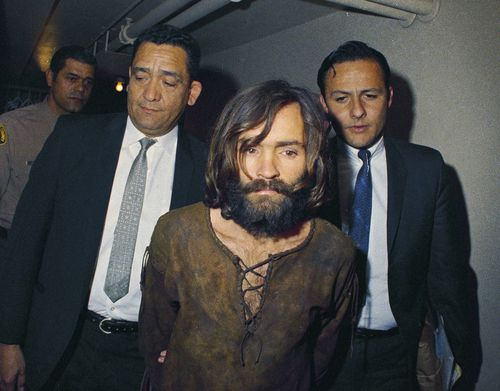In this 1969 file photo, Charles Manson is escorted to his arraignment on conspiracy-murder charges in connection with the Sharon Tate murder case. (AAP)