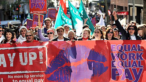 File photo of protestors take part in an 'Equal Pay' rally in Sydney. (AAP)