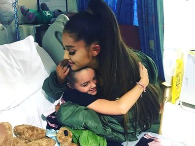 Victim of the Manchester concert blast Lily Harrison hugs singer Ariana Grande during her visit to the Royal Manchester Children's Hospital. Grande surprised young fans injured in the Manchester Arena attack, hugging the thrilled little girls in their hospital beds as they recovered from injuries sustained in the May 22, 2017 suicide bombing. The attack killed 23 people.