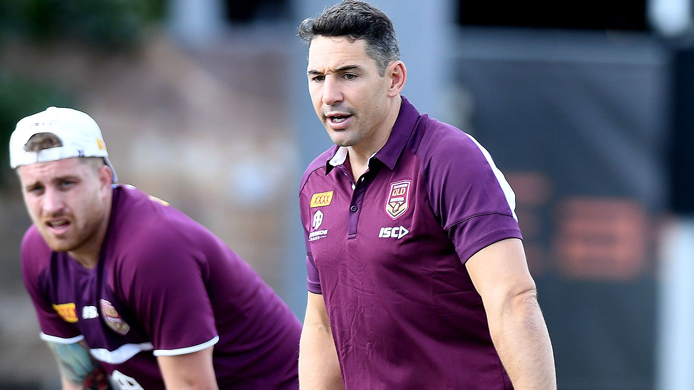Billy Slater gives some advice to Cameron Munster during a Queensland Maroons State of Origin training session at Langlands Park on July 04, 2019