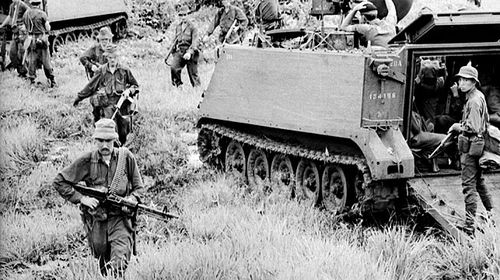 Troops of 1APC Squadron and infantry sweep the area the day after the battle of Long Tan in then Phuoc Tuy province of South Vietnam, now Ba Ria-Vung Tau province of Vietnam. (AAP)