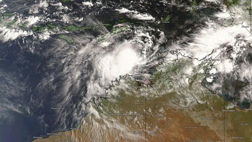 Satellite imagey showing the tropical low over the Arafura Sea on Friday.