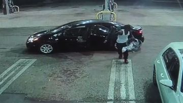 The thief took the baby to the entrance of the petrol station kiosk.