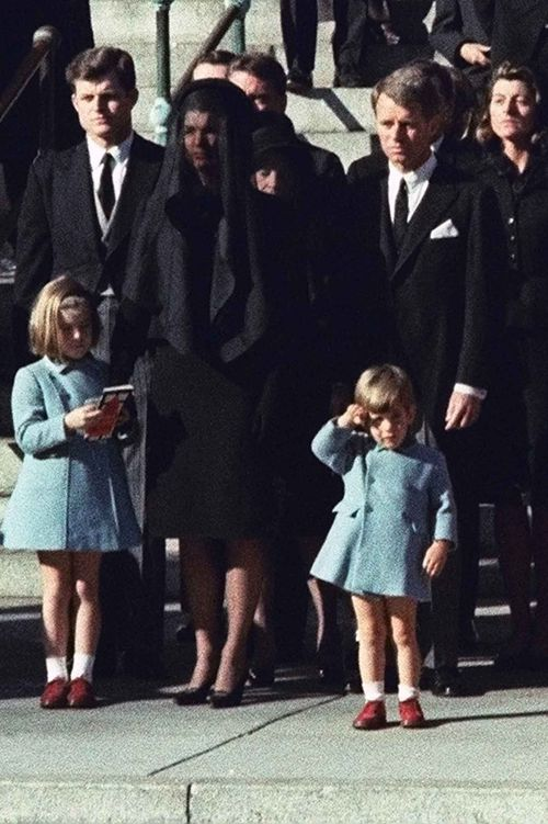 John F Kennedy Jr salutes his father's coffin at his funeral in 1963, alongside his uncles Ted (left) and Robert (right), and mother Jackie.