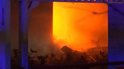 A woman and boy made a run for it when their Sydney home went up in flames last night.