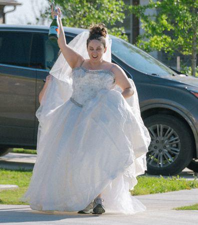 Jaime Sladek from Georgetown, Texas pose in their wedding dresses for fun social distancing photoshoot by neighbour Elyssa Seibel