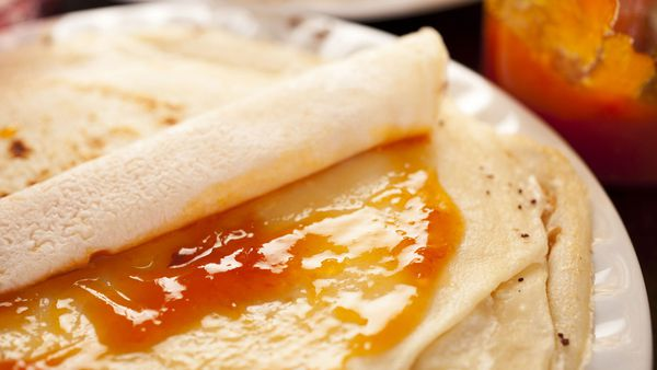 Mango and strawberry jam on crepes