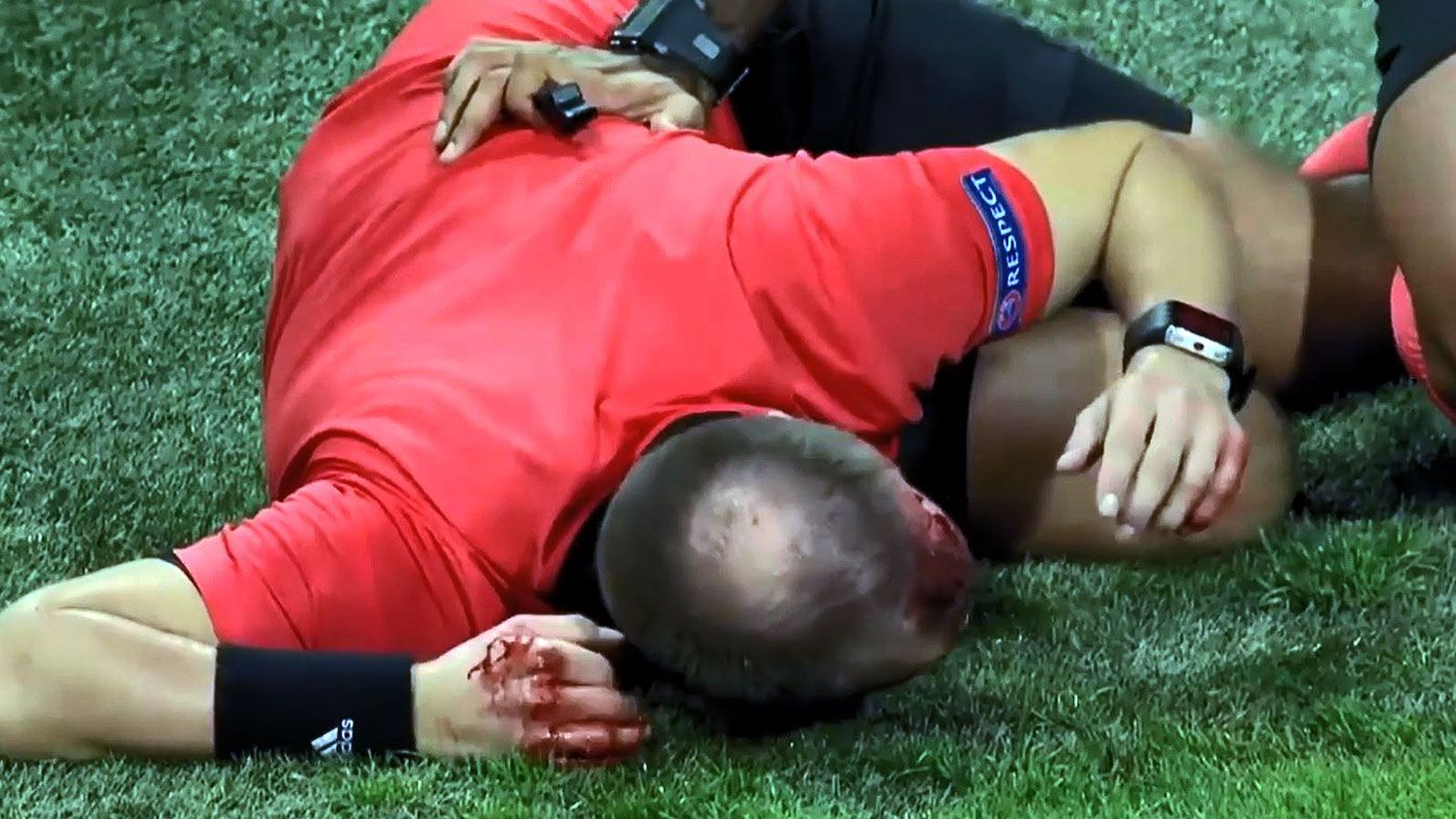 Football: Linesman cops nasty cut to head after crowd launch projectile in Europa League