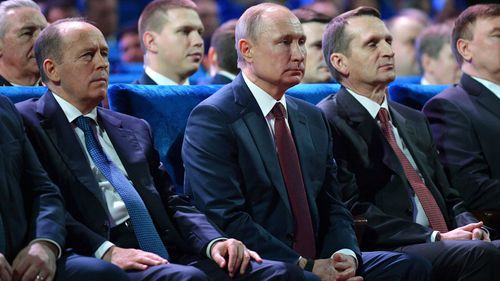 President Vladimir Putin, centre, Federal Security Service (FSB) Director Alexander Bortnikov, left, and Sergei Naryshkin, head of the Russian Foreign Intelligence Service, right, were at a meeting when the shooting occurred.