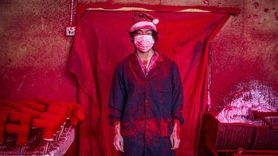 """<p>These are Santa's real helpers – thousands of kilometres away from the North Pole and working in conditions that are not too jolly.</p><p> AP photographer Yang Guang has captured in a rare look inside a """"Christmas Village"""" in China's Zhejiang province, filled with """"red factories"""" that produce Christmas products for the whole world. </p><p> (All images AAP)</p>"""
