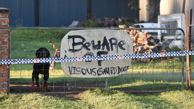 A sign warns of a guard dog at the rural Queensland property that has become the scene of a suspected murder-suicide. (AAP)